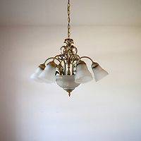 TAMPA, FL -- March 22, 2011 -- A chandelier hangs in a vacant home in North Port, Fla., 2011.  A recent study showed that one and five homes in the state of Florida is vacant.