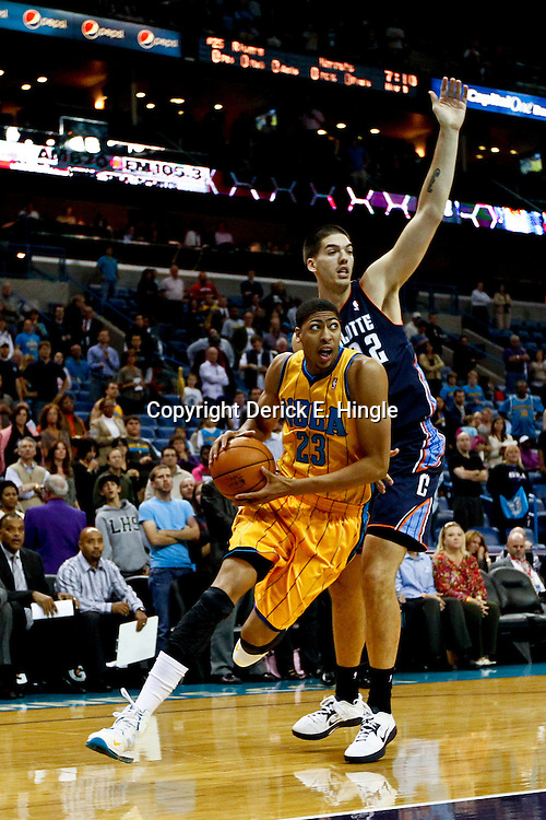 November 9, 2012; New Orleans, LA, USA; New Orleans Hornets power forward Anthony Davis (23) drives past Charlotte Bobcats center Byron Mullens (22) during the first half of a game at the New Orleans Arena. Mandatory Credit: Derick E. Hingle-US PRESSWIRE