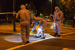 Forensics investigators work at the scene where a seventeen-year-old, the second teenager in less than 24 hours, was stabbed and died outside Clapham South Underground Station. Clapham South, London, November 02 2018.