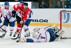 Stephen Murphy of Great Britain covers a puck in front of Janos Vas of Hungary during ice-hockey match between Hungary and Great Britain at IIHF World Championship DIV. I Group A Slovenia 2012, on April 21, 2012 at SRC Stozice, Ljubljana, Slovenia. (Photo By Matic Klansek Velej / Sportida.com)