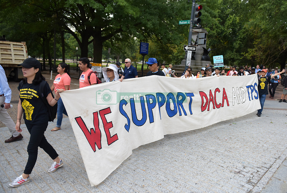 September 5, 2017  People attend a rally protesting against U.S. President Donald Trump's decision to end the Deferred Action for Childhood Arrivals (DACA) program in front of the White House in Washington D.C.. U.S. Attorney General Jeff Sessions said Tuesday the Deferred Action for Childhood Arrivals (DACA) program has been rescinded. The move potentially puts 800,000 illegal immigrants in danger of deportation. (Credit Image: © Yin Bogu/Xinhua via ZUMA Wire)