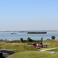 Fort Moultrie, Sullivan's Island, SC, USA. Fort Moultrie was used by the Confederates to bombard Fort Sumter at the beginning of the American Civil War. Fort Sumter is visible between the tugboat and the barge.