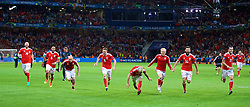 LILLE, FRANCE - Friday, July 1, 2016: Wales' James Collins, captain Ashley Williams, David Cotterill, Andy King, Aaron Ramsey and Jonathan Williams, Joe Ledley and Gareth Bale slide on the pitch as they celebrate after a 3-1 victory over Belgium and reaching the Semi-Final during the UEFA Euro 2016 Championship Quarter-Final match at the Stade Pierre Mauroy. (Pic by David Rawcliffe/Propaganda)