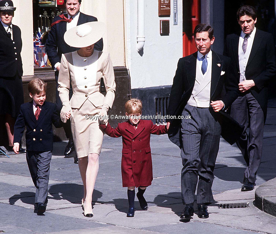 The Prince and Princess of Wales, with young Prince William and Harry at the wedding of Duke Hussey's daughter in Bath, May 1989.<br />