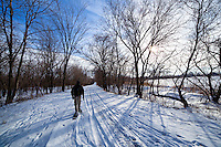 Snowshoeing along a trail near Saylorville Lake, Iowa after the first major snowfall of the season. Model: Jessie Coffman