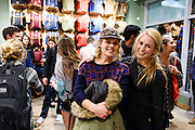 Guests mingle and look at clothing apparel and outdoor-outfitter gear during a grand opening event for Fjällräven Madison, a Swedish-heritage brand store in downtown Madison, Wis., on Oct. 22, 2015. Pictured at right is Leah Stieber, manager of the Fjällräven Madison Store. (Photo by Jeff Miller - www.jeffmillerphotography.com)