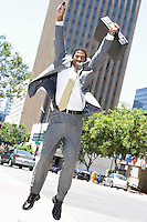 Businessman jumping at street