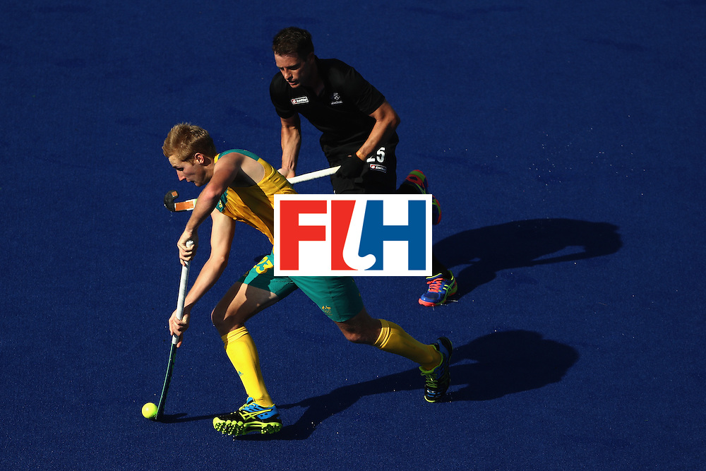 RIO DE JANEIRO, BRAZIL - AUGUST 06:  Daniel Beale #23 of Australia runs past Shea Mcaleese #25 of New Zealand during a Pool A match between New Zealand and Austraiia  on Day 1 of the Rio 2016 Olympic Games at the Olympic Hockey Centre on August 6, 2016 in Rio de Janeiro, Brazil.  (Photo by Sean M. Haffey/Getty Images)