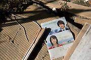 """A plastic folder advertising the """"Yucho Account"""" of the post office bank lies among the rubble inside the post office at Minami Sanriku, Japan on Tuesday 24 May 2011. """"The Yucho account -- the entrance to adulthood"""" reads the catch-copy on the folder..Photographer: Robert Gilhooly"""