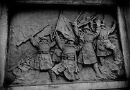"Bronze relief of victorious Japanese soldiers shouting, ""banzai"" after battle in China that has been mounted into a giant lantern on the approach to the controversial Yasukuni War Shrine where class A war criminals are enshrined with rank and file Imperial Army soldiers.  Tokyo, Japan.  Japanese politician visits to Yasukuni War Shrine inevitably result in protests by the governments of South Korea and China."