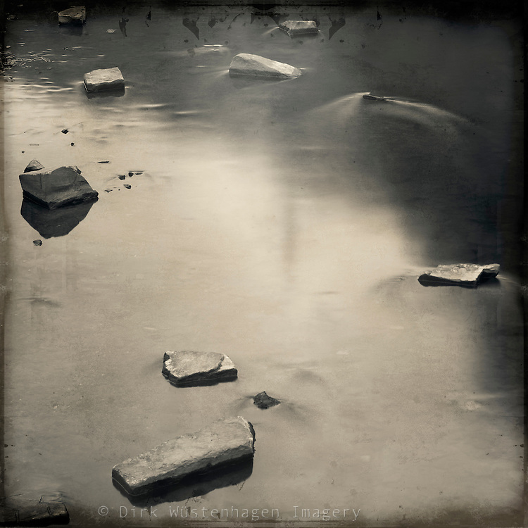 Stones in a slow flowing river