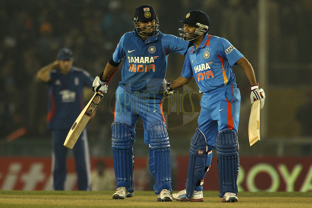 Suresh Raina of India and Rohit Sharma of India celebrate their fifty partnership during the 4th Airtel ODI Match between India and England held at the PCA Stadium, Mohal, India on the 23rd January 2013..Photo by Ron Gaunt/BCCI/SPORTZPICS ..Use of this image is subject to the terms and conditions as outlined by the BCCI. These terms can be found by following this link:..http://www.sportzpics.co.za/image/I0000SoRagM2cIEc