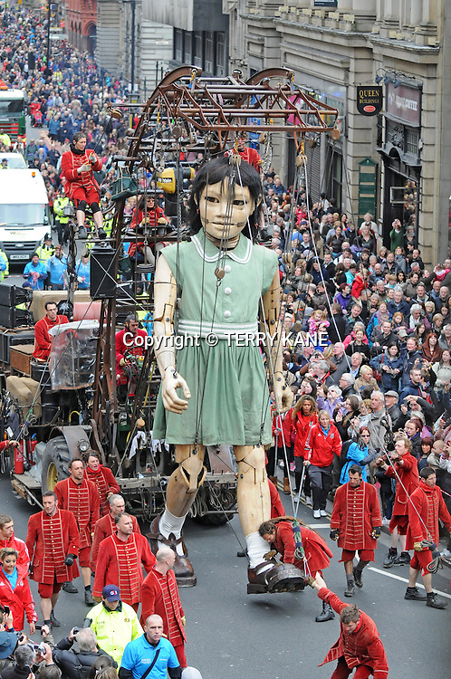 LIVERPOOL, UNITED KINGDOM :.The giant girl in Liverpool, on the second day of a  three-day street theatre event inspired by the Titanic on April 21, 2012 in Liverpool, England. .PHOTO BY TERRY KANE.+44 (0)7974 921 220