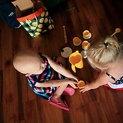 Holly Larue Frizzelle plays at her best friend's home during July 4th. This was the first time she was able to play with other children during the summer due to treatment.