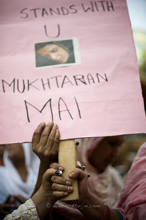 Women's rights activists protest against the Supreme Court's decision in the Mukhtar Mai rape case outside the Karachi Press Club. The court judgment acknowledged that Mai had been raped, yet freed all but one of the  men accused in the notorious gang rape that took place under orders from a village council in 2002. <br /> Now fearing for her life, Mukhtar Mai said she was afraid of her life and now had to trust the court of God to uphold justice. Karachi, Pakistan, 2011.