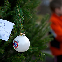 A note of support is hung on a community christmasy tree in town the day after a mass shooting of 20 children and 7 adults at Sandy Hook Elementary School, in Sandy Hook, CT on December 14, 2012.