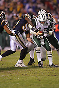 SAN DIEGO, CA - JANUARY 8:  Quarterback Chad Pennington #10 of the New York Jets gets sacked by linebackers Shaun Phillips #95 and Steve Foley #53 of the San Diego Chargers. Pennington still completed 23 of 33 passes for 279 yards and 2 touchdowns against the Chargers at Qualcomm Stadium on January 8, 2005 in San Diego, California. The Jets defeated the Chargers 20-17 in overtime in the AFC Wild Card Game. ©Paul Anthony Spinelli  *** Local Caption *** Chad Pennington; Shaun Phillips; Steve Foley