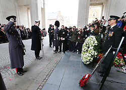 The Duke of Edinburgh and and Prince Laurent of Belgium  salute after laying wreaths at the Menin Gate in Ypres, Belgium, at a ceremony on Armistice Day to mark the gathering of soil for the Flanders Fields Memorial Garden at the Guards Museum in London, Monday, 11th November 2013. Picture by Stephen Lock / i-Images