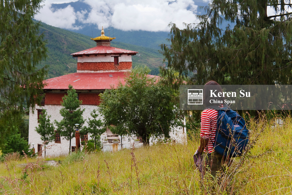 Traveler with National Museum, Ta Dzong, Paro, Bhutan