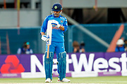 India ODI wicket keeper MS Dhoni inspects his bat during the 3rd Royal London ODI match between England and India at Headingley Stadium, Headingley, United Kingdom on 17 July 2018. Picture by Simon Davies.