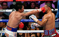 LAS VEGAS, NEVADA - JULY 20. <br /> Manny Pacquiao (L) hits Keith Thurman in the third round of their WBA welterweight title fight at MGM Grand Garden Arena on July 20, 2019 in Las Vegas, Nevada. Pacquiao took the win by a split decision.  (MB Media)