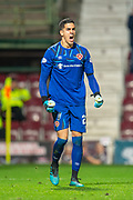 Joel Pereira (#23) of Heart of Midlothian FC screams for joy after saving a penalty during the penalty shoot out at the end of Betfred Scottish Football League Cup quarter final match between Heart of Midlothian FC and Aberdeen FC at Tynecastle Stadium, Edinburgh, Scotland on 25 September 2019.