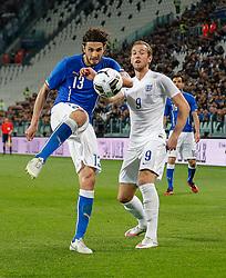 Andrea Ranocchia of Italy clears past Harry Kane of England - Photo mandatory by-line: Rogan Thomson/JMP - 07966 386802 - 31/03/2015 - SPORT - FOOTBALL - Turin, Italy - Juventus Stadium - Italy v England - FIFA International Friendly Match.