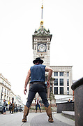 Brighton Fringe launch event.<br /> Head First Acrobats perform an acrobatic gun-fight underneath the Jubilee Clock Tower at the top of West Street as it strikes 12 noon (pastiche of the climax of Gary Cooper showdown from 1952 classic western High Noon)<br /> Head First Acrobats show Railed a Wild West Circus extravaganza is its UK premiere.opens 4th May 2019 to 1st June 2019 <br /> At the <br /> Jubilee Clock Tower, Brighton, Great Britain <br /> Press photo call <br /> 3rd May 2019 <br /> <br /> <br /> Callan Harris<br /> Adam O'Connor-McMahon<br /> Harley Timmermans<br /> <br /> Photograph by Elliott Franks