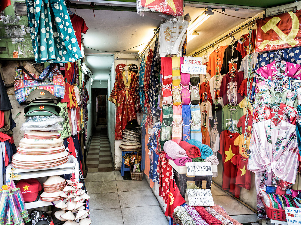 Small shop of a Hanoi residence filled with silk garments along Hang Gai 'silk street' in the Old Quarter, Hanoi, Vietnam, Southeast Asia