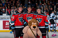 KELOWNA, CANADA - DECEMBER 2: Kole Lind #16 Conner Bruggen-Cate #20 and Kyle Topping #24 of the Kelowna Rockets pose with a teddy bear during the annual teddy bear toss against the Kootenay Ice on December 2, 2017 at Prospera Place in Kelowna, British Columbia, Canada.  (Photo by Marissa Baecker/Shoot the Breeze)  *** Local Caption ***
