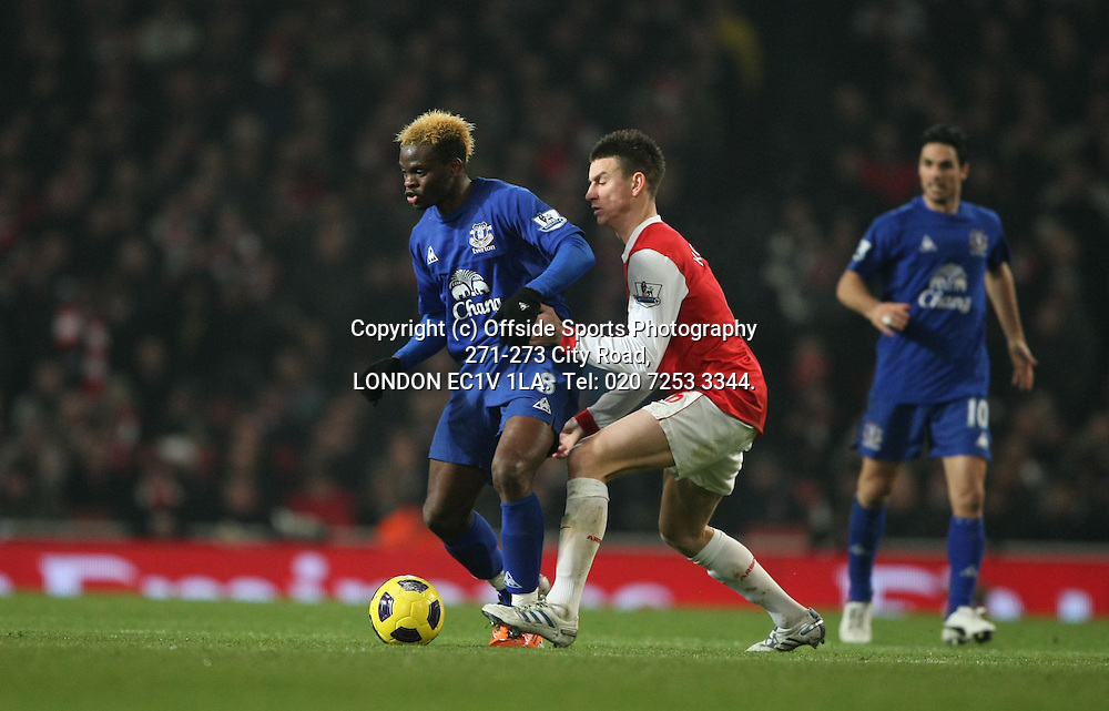 01/02/2011 Premier League football. Arsenal v Everton.<br /> Louis Saha and Laurent Koscielny.<br /> Photo: Mark Leech.