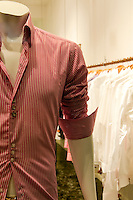 Mannequin in window store showcase informal shirt.