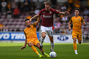 Newport County midfielder Robbie Wilmott (7) fouls Northampton Town midfielder Chris Lines (14) during the EFL Sky Bet League 2 match between Northampton Town and Newport County at the PTS Academy Stadium, Northampton, England on 14 September 2019.