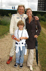 "DEREK & MISTI BELL with their son SEBASTIAN at the Goodwood Festival of Speed on 9th July 2006.  Cartier sponsored the ""Style Et Luxe' for vintage cars on the final day of this annual event at Goodwood House, West Sussex and hosted a lunch.<br />