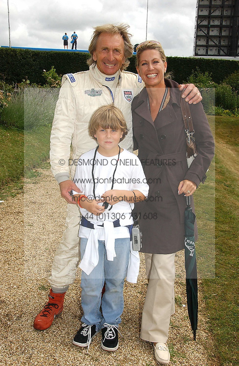 """DEREK & MISTI BELL with their son SEBASTIAN at the Goodwood Festival of Speed on 9th July 2006.  Cartier sponsored the """"Style Et Luxe' for vintage cars on the final day of this annual event at Goodwood House, West Sussex and hosted a lunch.<br /><br />NON EXCLUSIVE - WORLD RIGHTS"""
