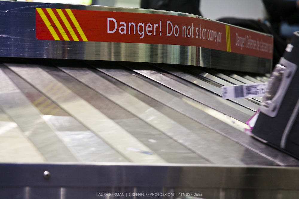 """Airport luggage carousel """"Danger"""" sign."""