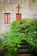 Red door and overgrown steps, Mont Saint-Michel, Normandy, France