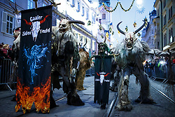 03.12.2017, Innenstadt, Graz, AUT, Krampus- und Perchtenlauf in Graz, im Bild Mitglieder verschiedener Krampusgruppen beim Krampusumzug // A man dressed as a devil performs during a Krampus show. Krampus a mythical creature that, according to legend, accompanies Saint Nicholas during the festive season. Instead of giving gifts to good children, he punishes the bad ones, Graz, Austria on 2017/12/03, EXPA Pictures © 2017, PhotoCredit: EXPA/ Erwin Scheriau