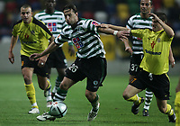 """PORTUGAL - AVEIRO 20 NOVEMBER 2004: (L to R) ROCHEMBACK #26 and BETO #7 battle for the ball  in the 11¼ leg of the Super Liga, season 2004/2005, match  SC Beira Mar vs Sporting CP, held in """"Mario Duarte"""" stadium,  20/11/2004  21:30:48<br />(PHOTO BY: NUNO ALEGRIA/AFCD)<br /><br />PORTUGAL OUT, PARTNER COUNTRY ONLY, ARCHIVE OUT, EDITORIAL USE ONLY, CREDIT LINE IS MANDATORY AFCD-PHOTO AGENCY 2004 © ALL RIGHTS RESERVED"""