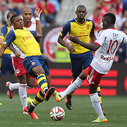 Chuba Akpom, (left), Arsenal, challenges Lloyd Sam, New York Red Bulls, during the New York Red Bulls Vs Arsenal FC,  friendly football match for the New York Cup at Red Bull Arena, Harrison, New Jersey. USA. 26h July 2014. Photo Tim Clayton