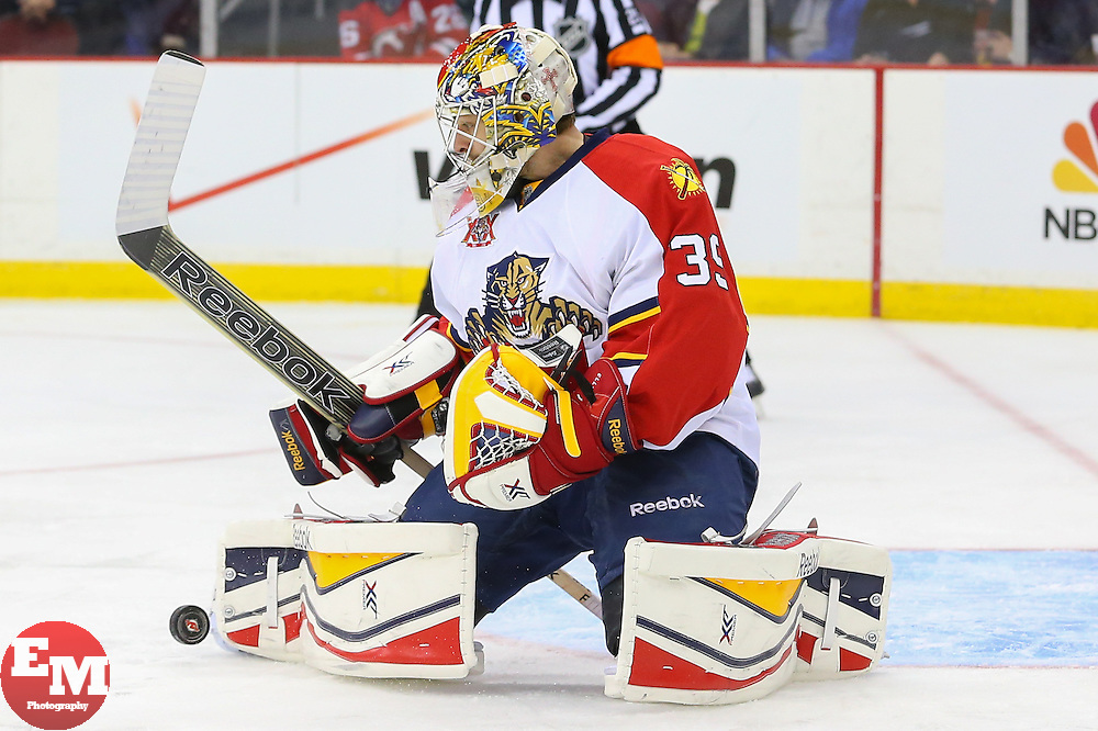Mar 31, 2014; Newark, NJ, USA; Florida Panthers goalie Dan Ellis (39) makes a pad save during the first period at Prudential Center.