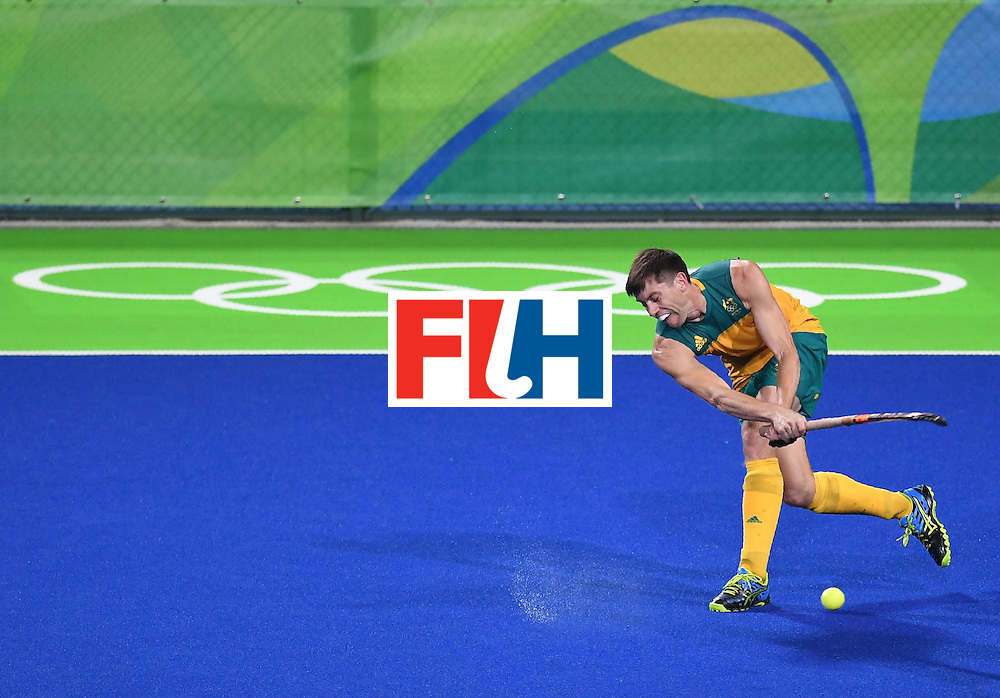 Australia's Eddie Ockenden hits the ball during the men's field hockey Belgium vs Australia match of the Rio 2016 Olympics Games at the Olympic Hockey Centre in Rio de Janeiro on August, 9 2016. / AFP / MANAN VATSYAYANA        (Photo credit should read MANAN VATSYAYANA/AFP/Getty Images)