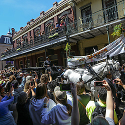 A horse drawn carriage carrying the casket of Tom Benson is brought up Chartres Street as part of a second line following the funeral service for NFL New Orleans Saints owner and NBA New Orleans Pelicans owner Tom Benson in New Orleans, Friday, March 23, 2018. Benson died last Thursday at the age of 90. (AP Photo/Derick Hingle)
