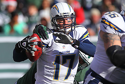 Dec 23, 2012; East Rutherford, NJ, USA; San Diego Chargers quarterback Philip Rivers (17) is sacked during the first half at MetLIfe Stadium.