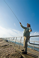 Fly fishing off the Packery Channel jetty on Mustang Island, Texas Gulf Coast.