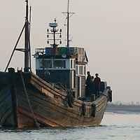 SHINIUJU, , OCTOBER-26:a Chinese boat waits for sailing permission to the town of Shiniuju in the Yalu river in Shiniuju,and North Korea ,October 26,2006.