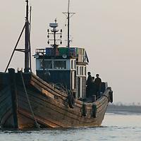 SHINIUJU, , OCTOBER-26:a Chinese boat waits for sailing permission to the town of Shiniuju in the Yalu river in Shiniuju,and North Korea ,October 26,2006.