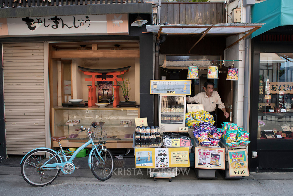 Scene in the Omotesando Shopping Arcade on Miyajima Island, Hiroshima Prefecture, Japan.
