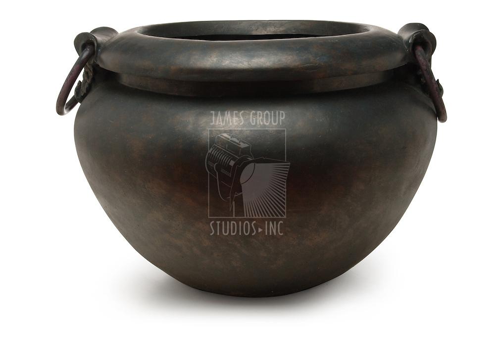 black iron cauldron on white background