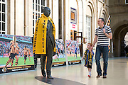 16 May 2014: Simon Latus and his son Harry (5) walk past a statue of poet Philip Larkin decked out in Hull City colours  at Hull Train Station this afternoon on their way to the FA Cup Final at Wembley tomorrow.<br /> Picture: Sean Spencer/Hull News & Pictures Ltd<br /> 01482 772651/07976 433960<br /> www.hullnews.co.uk   sean@hullnews.co.uk
